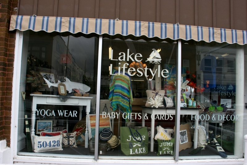 Creative window displays draw shoppers into businesses like Lake Lifestyle.