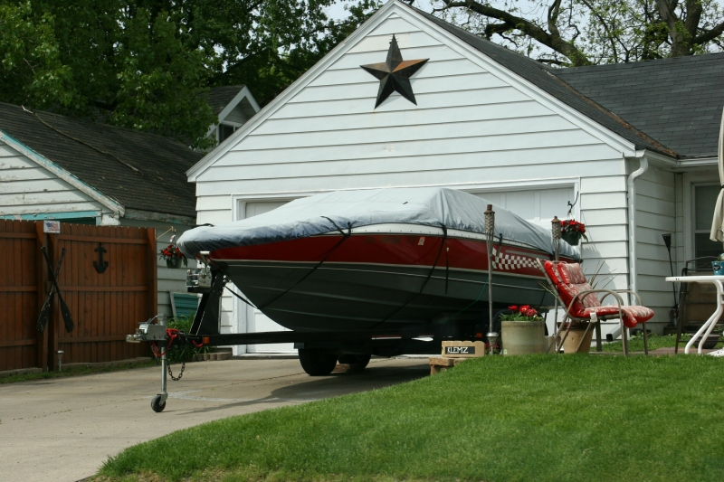 You'll see lots of boats, like this one parked in a residential driveway.