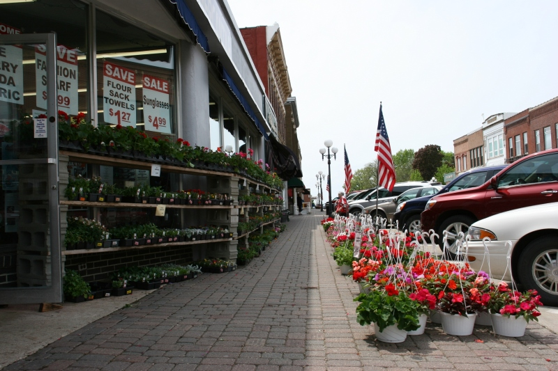 Flowers and plants bordered two three sides of the corner Larson's Mercantile, a popular stop for shoppers.