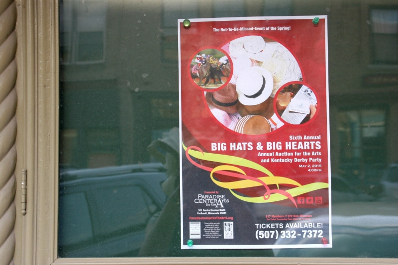 A poster in an exterior window promotes the Derby event.