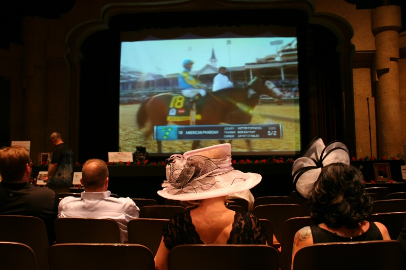 Fans watched the race on the big screen in the theatre.