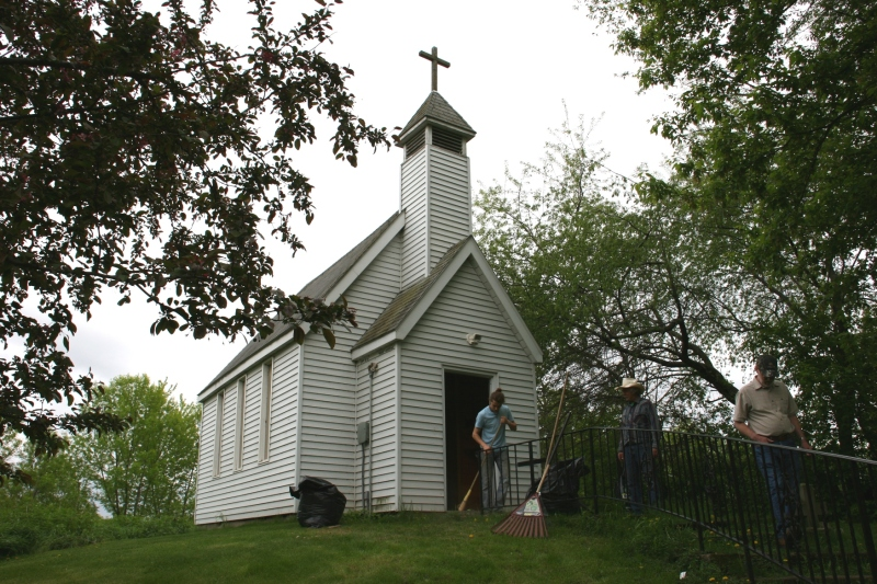 My husband, Randy, leaves the Guardian Angel Roadside Chapel as Scott Kennedy and his nephew finish cleaning.