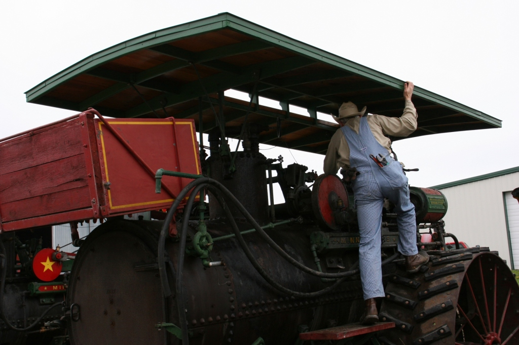Checking out a steam engine tractor during Steam School.