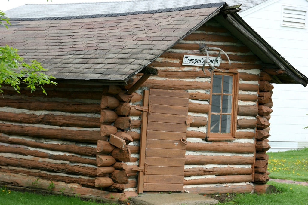 Several log cabins are on site, including this trapper's cabin.