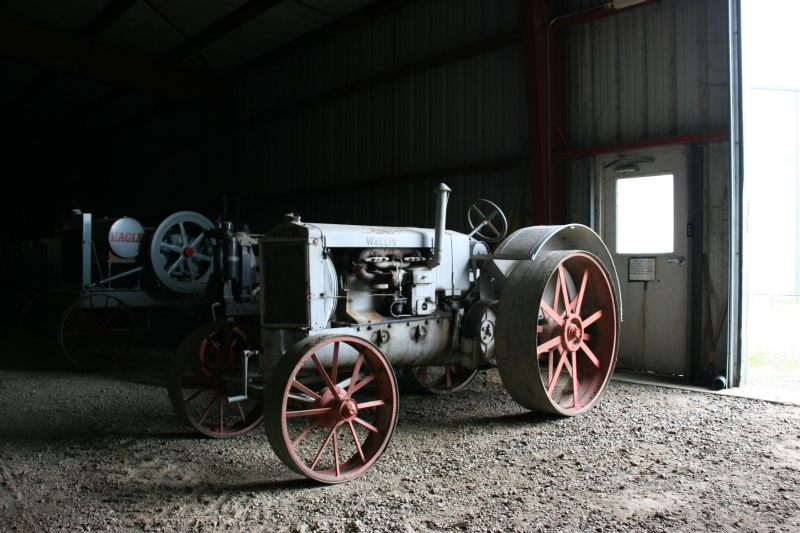 A Wallis tractor was among the many tractors stored in a massive building.