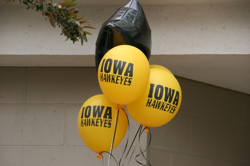 Balloons marked a graduation reception at a public rental space in the lakeside park.