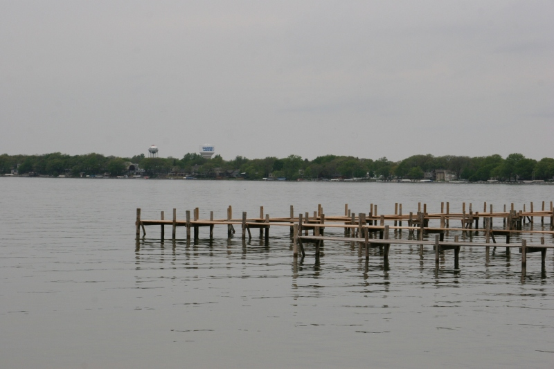 The public dock stretches and corners into Clear Lake.
