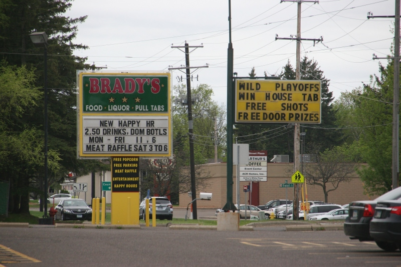 "Then I turned to the right to photograph these roadside messages posted to draw customers into Brady's a ""local bar with great service and a wonderful fun filled atmosphere."""