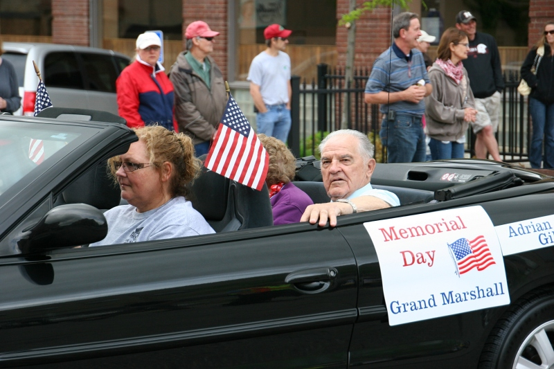 Honorary Grand Marshall, Adrian Gillen, rides in the parade alongside his wife, Jean. The couple both served their country and were duo grand marshalls.