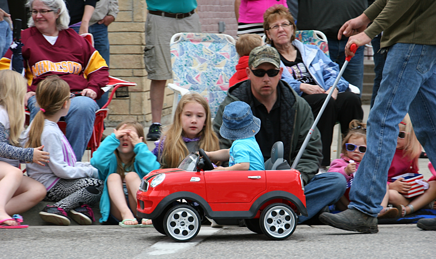 a photo essay celebrating memorial day in faribault minnesota little ivan arrives for the parade in a car pushed by his dad jake
