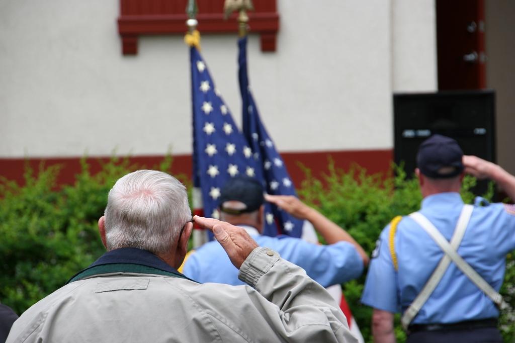 Saluting the flag.