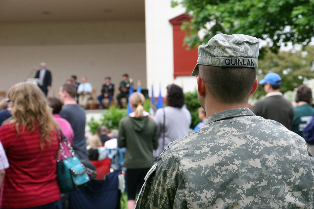 Veterans Travis Quinlan watches the program at the park with hundreds of others.