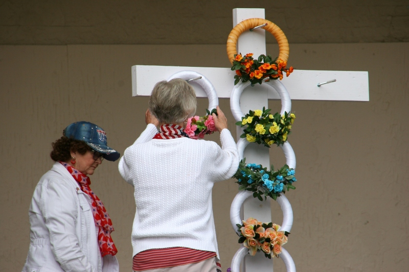 As is tradition each year, members of American Legion Auxiliary Unit 43 place wreaths on the memorial cross.