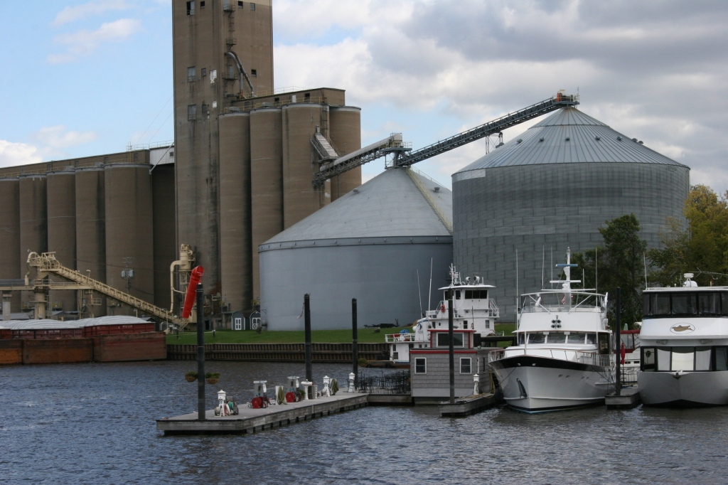 Recreation (boats) and commerce (grain elevator and bins) mingle here.