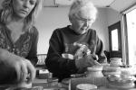 Mom counting jars of horseradish2013