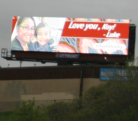 A personalized Mother's Day message on a billboard momentarily distracts me.