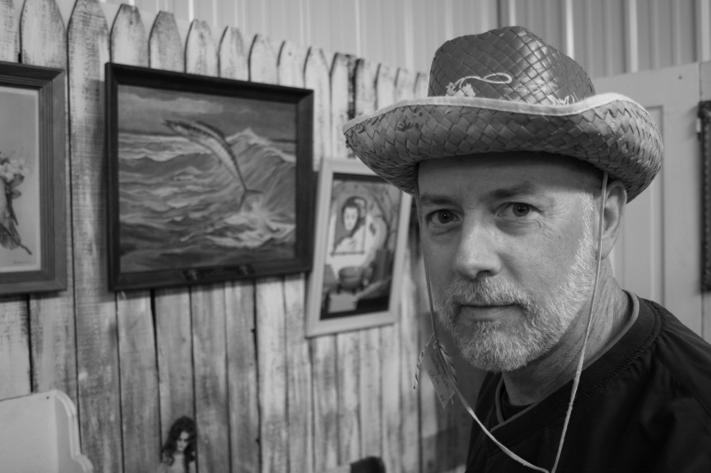 Modeling a vintage straw cowboy hat, like those we wore as children, in a North Mankato antique shop several years ago.