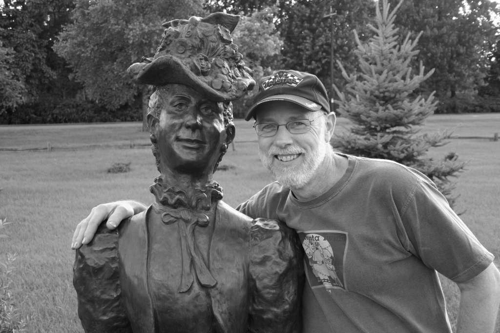Randy obliges my request to pose with a sculpture in a Prairie du Chien, Wisconsin, park we toured while vacationing.