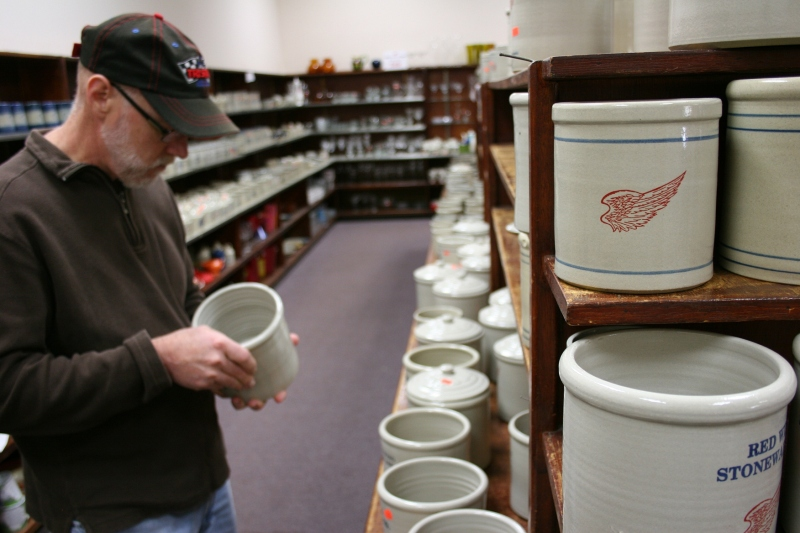 "My husband peruses pottery in the ""seconds"" section of the store."