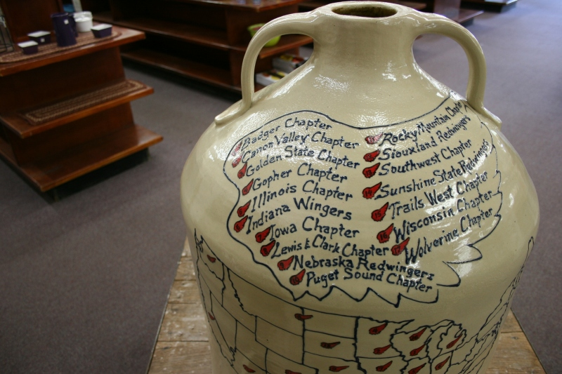 A large jug inside the pottery store lists chapters of the Red Wing Collectors Society.