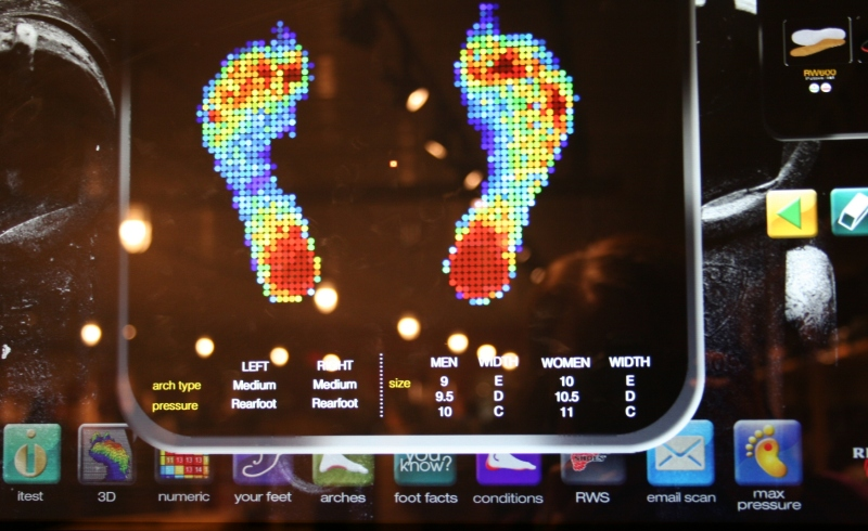 Randy stepped onto a machine which determined pressure points on this feet and projected the results onto a screen.