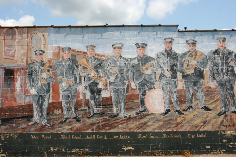 A mural of the 1906 Bohemian Brass Band adds artsy interest to the side of a building. However, the mural, painted in 1989, could use some freshening.