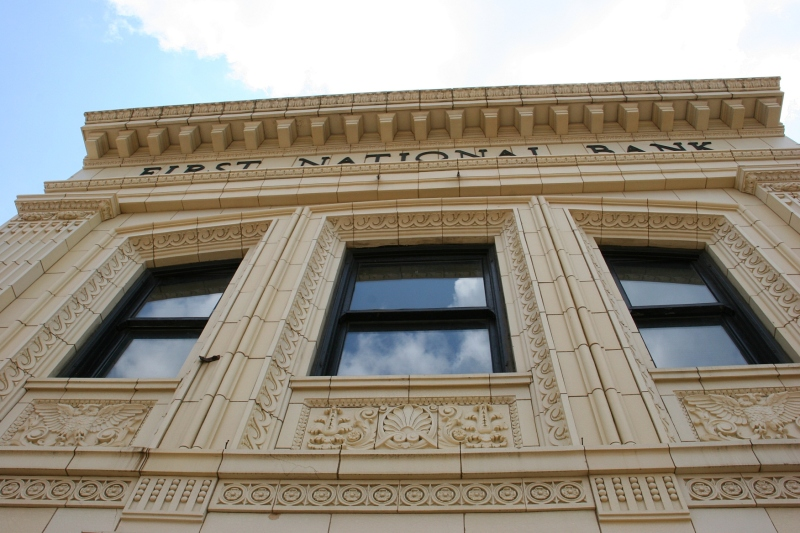 Looking up at the ornate architecture on the former First National Bank.