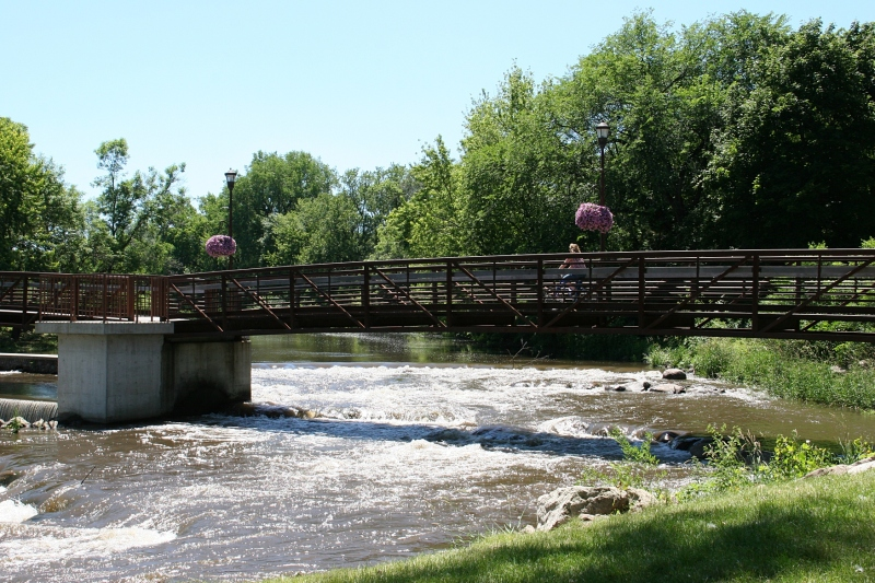 A recreational trail slices through Morehouse Park, bridging the Straight River.