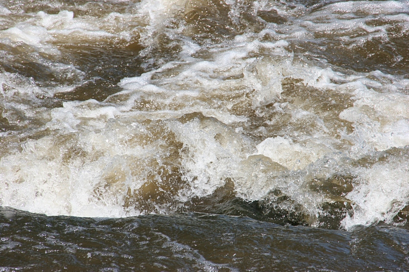 Water roars over rocks in the Straight River at Moreshouse Park.