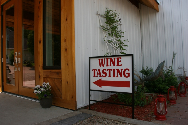 A sign directs visitors to the tasting room.