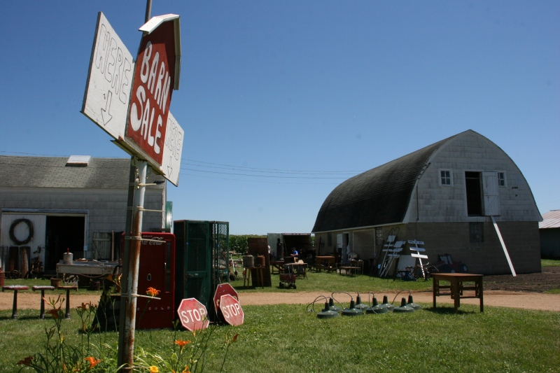 Park along the edge of the circle drive or on Frontage Road and then amble up to the Barn Sale.