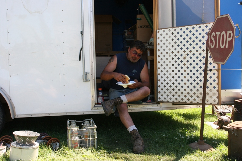 A vendor takes a lunch break.