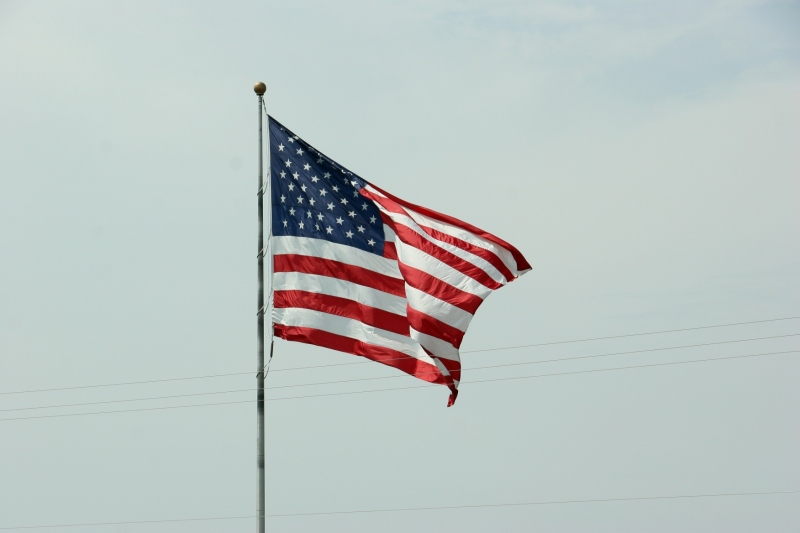 An American flag flies at the Perkins restaurant in North Mankato on Sunday afternoon.