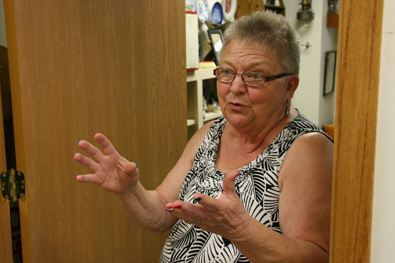 Audre Johnson loves to chat it up with customers. She talks with her hands while she talks. And lovely hands they are, too, with those patriotic red, white and blue polished fingernails.