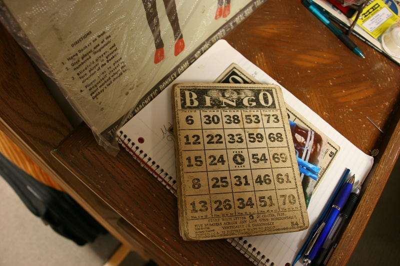 Underneath the top bingo card is the bingo card photo frame Audre crafted. And below that is a notebook where customers can jot down items they are searching for.