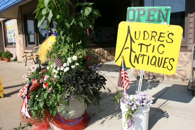 An exterior sign marks Audre's shop.