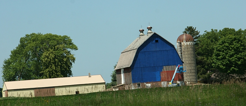 You can see how the barn looked before it was painted blue.