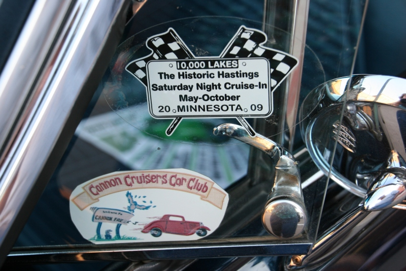 A vehicle sports stickers for area car cruises.