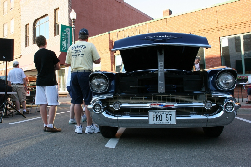 Interested in what's under the hood? Many hoods are open at car shows.