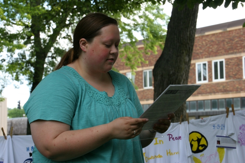 Laci Brune, sexual assault coordinator for the Crisis Resource Center of Steele County, reads the names of those who died as a result of domestic violence in Minnesota in 2014.