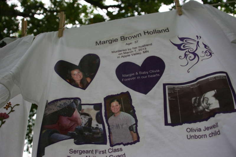 Margie Brown Holland and her unborn daughter, Olivia, were honored at The Clothesline Project display this summer in Owatonna. The Minnesota Coalition for Battered Women coordinates the project to honor victims of domestic violence. Redeemer Lutheran Church brought the project to Owatonna this past summer.