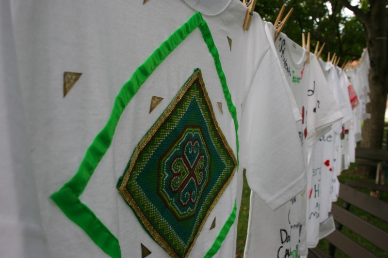 Clothesline Project, t-shirts in a row, green design