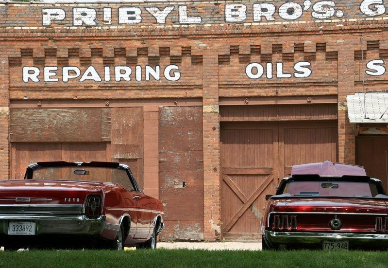 I absolutely love this aged building along Elysian's Main Street. These two cars were in the car show.