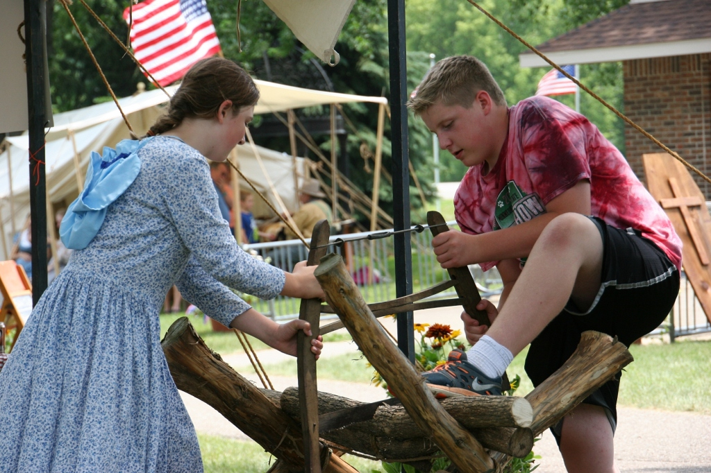 Sawing wood the old-fashioned way next to the Farmer's Friends 4-H Club tent.