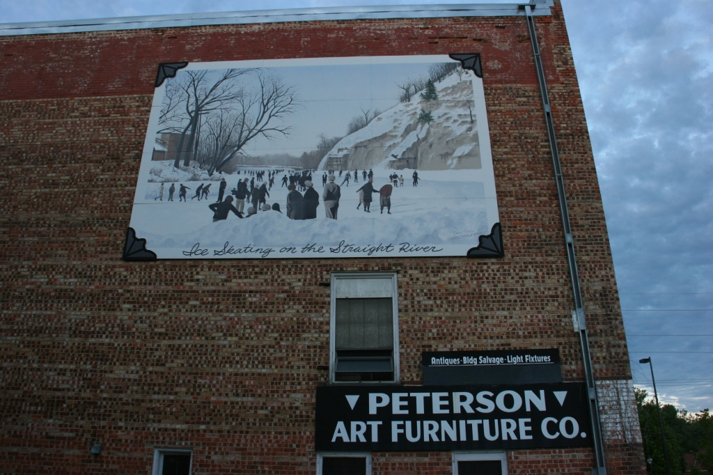 When you're sipping on the patio, don't miss this mural of iceskaters on the Straight River.