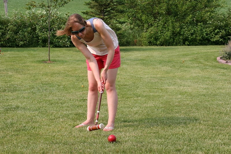 My eldest daughter takes her turn during one of many games of croquet.