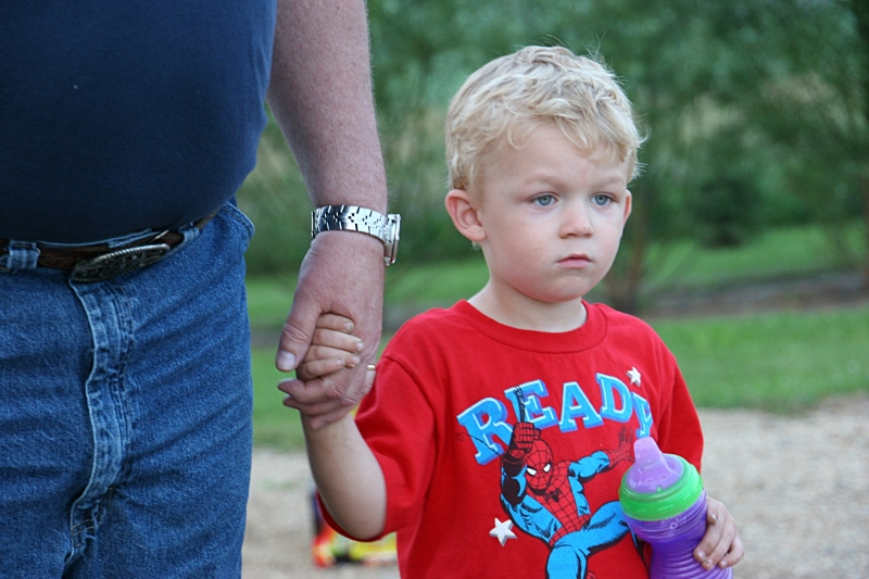 At the end of a long day, my three-year-old great nephew grips his grandpa's hand.