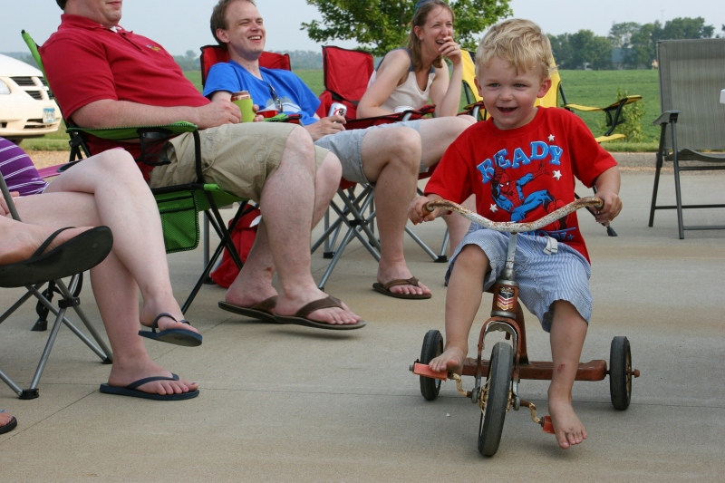 My great nephew barrels his way between the lawnchairs on his way to an imaginary fire.