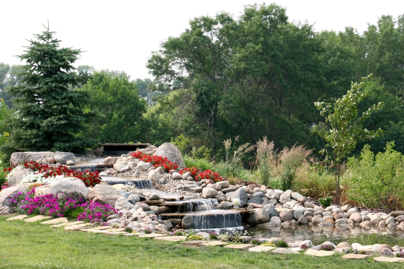 The view from the patio is this newly-completed waterfall and pond. Beautiful.
