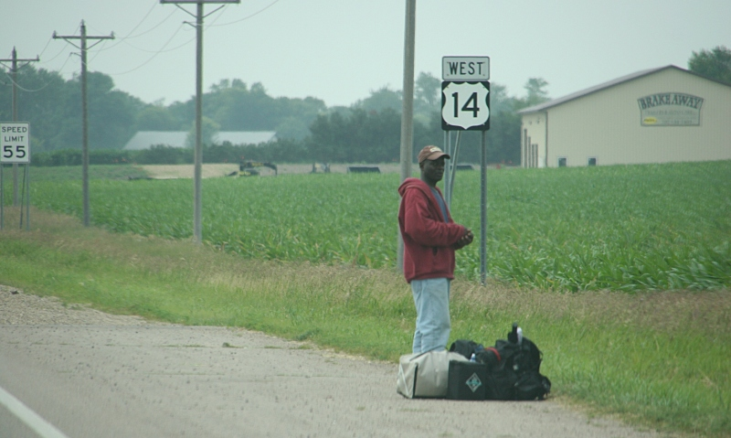 Hitchhiker at Sanborn Corners on the Fourth of July